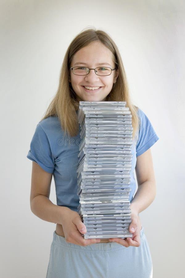 Ragazza sorridente con i suoi Cd immagine stock libera da diritti