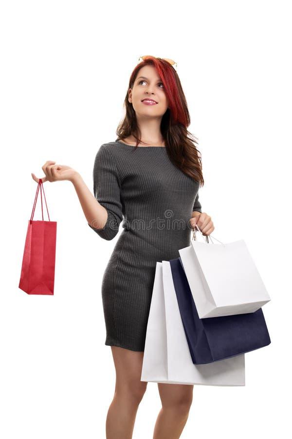 Ragazza sorridente con molti sacchetti della spesa immagine stock
