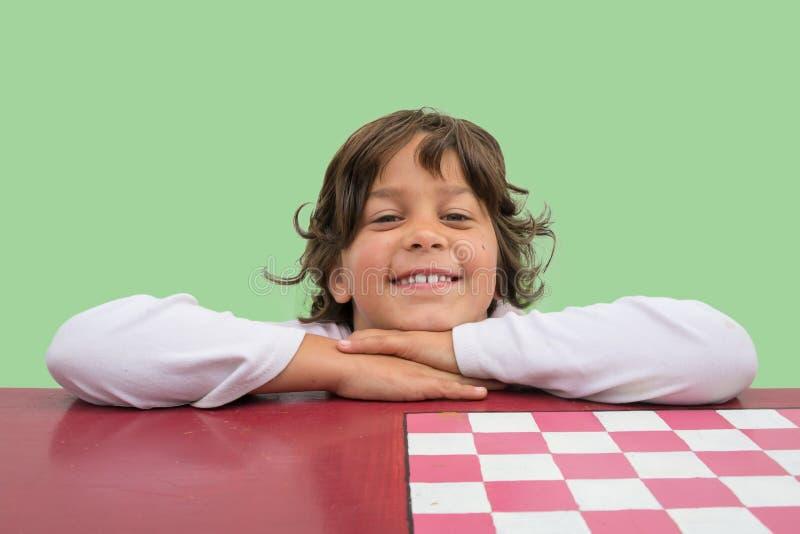 Ragazza sorridente del bambino a scuola immagine stock
