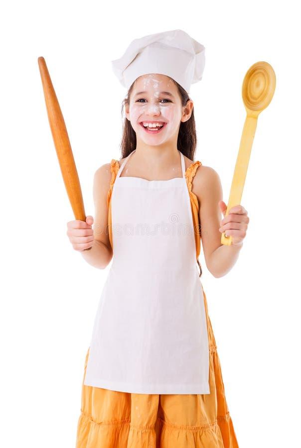 Ragazza sorridente del cuoco unico con la siviera ed il matterello immagine stock libera da diritti