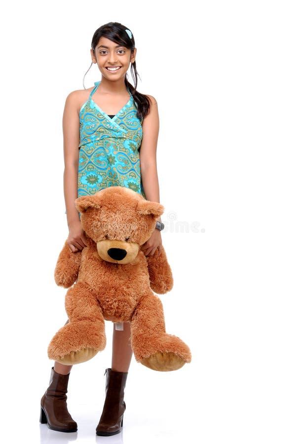 Ragazza sorridente felice con l'orsacchiotto immagini stock libere da diritti