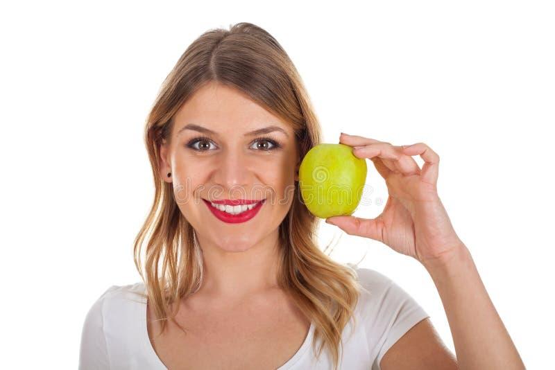 Ragazza sulla dieta che tiene una mela verde fotografia stock