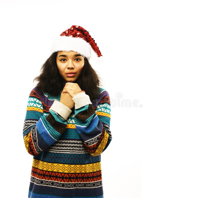 Ragazza sveglia in cappello rosso di Santa isolato fotografie stock libere da diritti