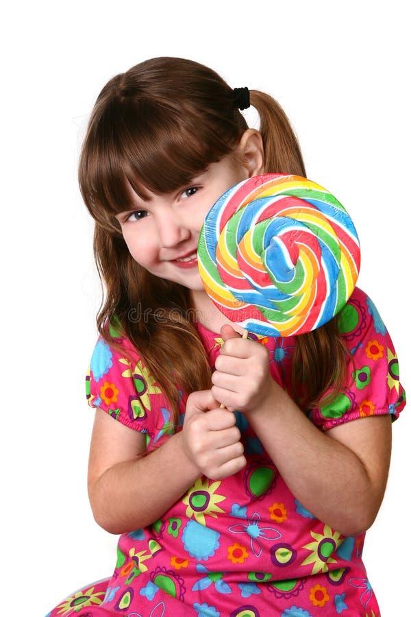 Ragazza sveglia che tiene grande Lollipop fotografia stock