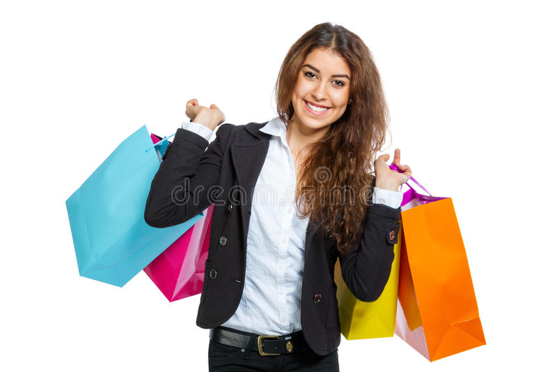 Ragazza sveglia con i sacchetti della spesa immagine stock libera da diritti