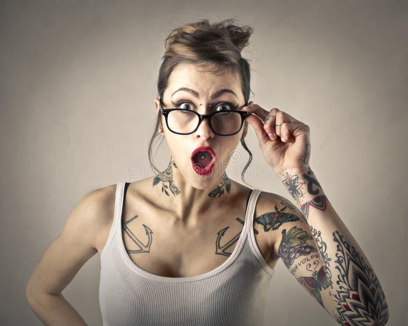 Ragazza tatuata fotografia stock