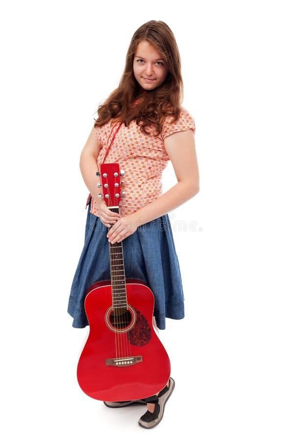Ragazza teenager con la chitarra immagine stock libera da diritti