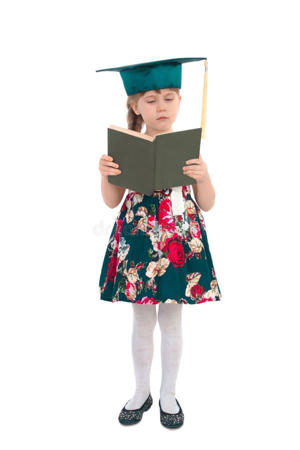 Ragazza in un cappello con un libro fotografia stock