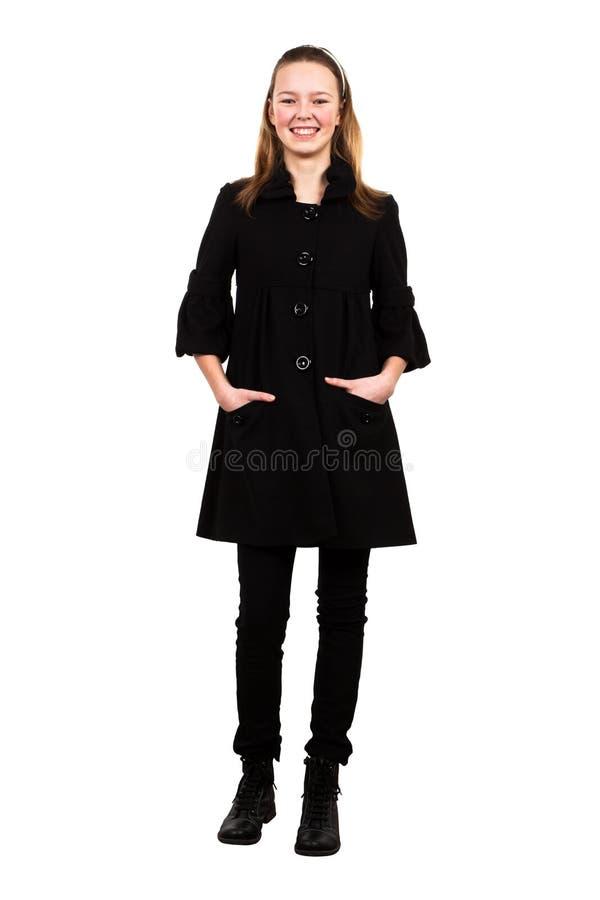 Ragazza in un cappotto nero fotografia stock libera da diritti
