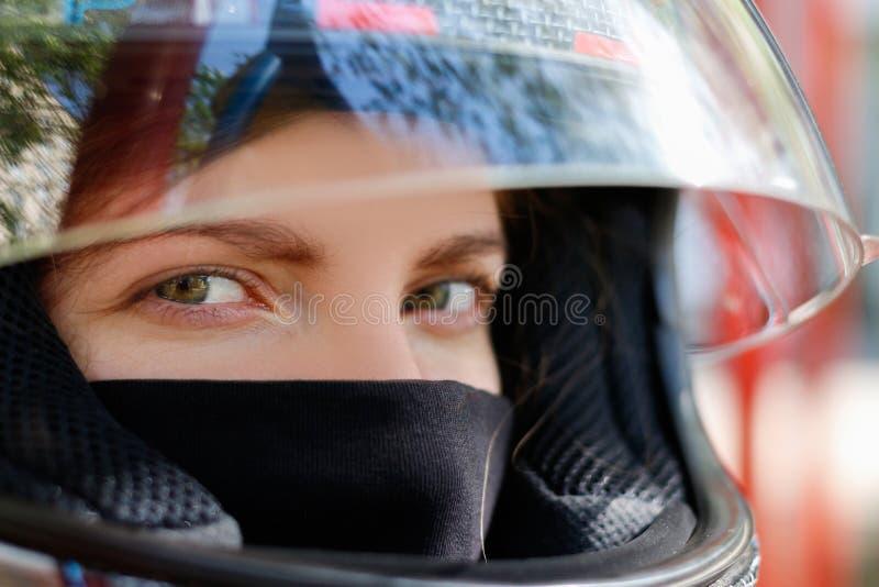 Ragazza in un casco del motociclo fotografia stock