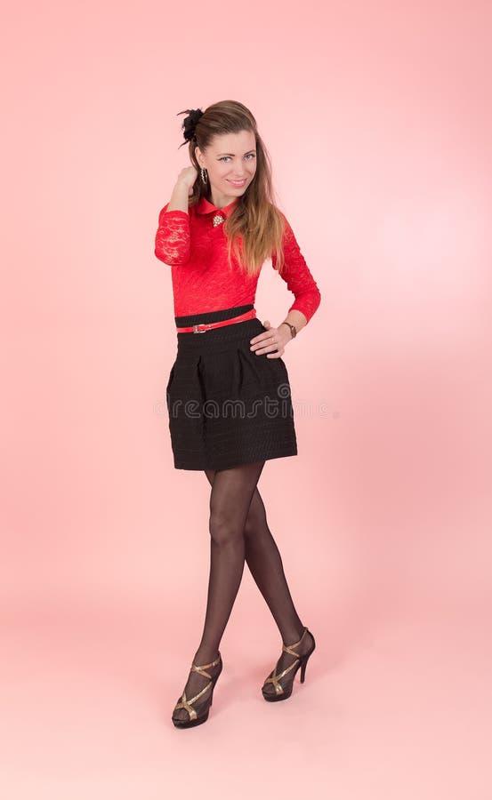 Ragazza in una blusa rossa fotografie stock