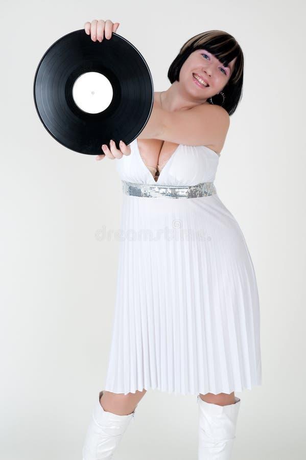 Ragazza in vestito con il disco del vinile immagine stock