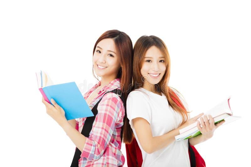 Ragazze adolescenti felici degli studenti isolate su bianco fotografia stock libera da diritti
