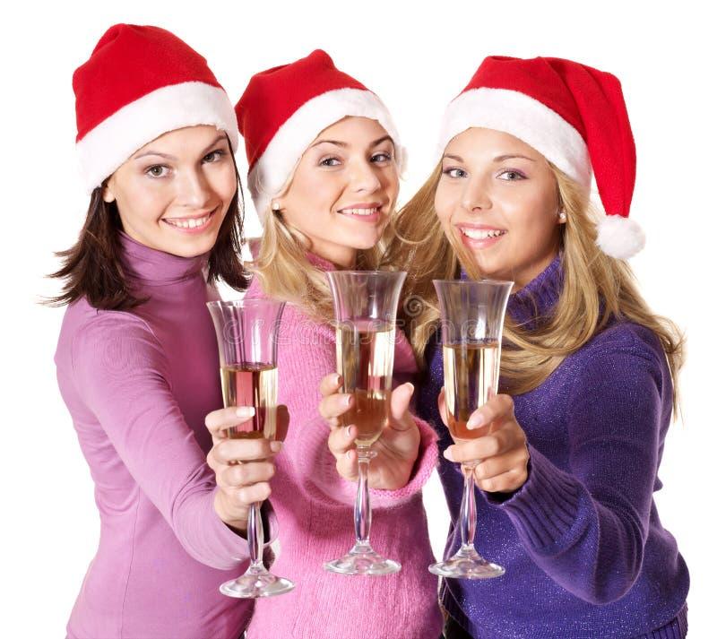 Ragazze in champagne bevente del cappello della Santa fotografie stock libere da diritti