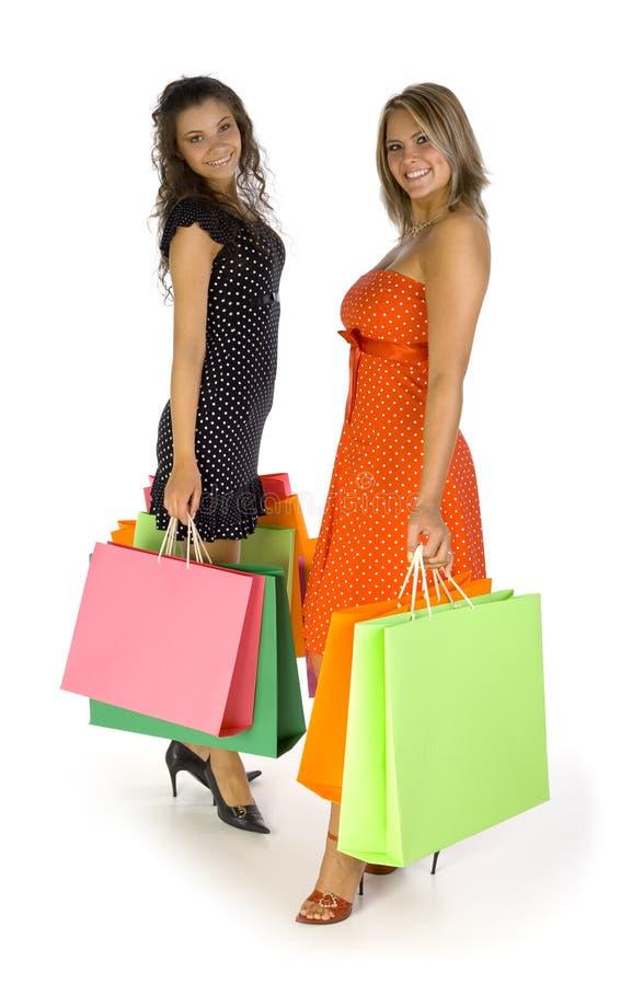 Ragazze con i sacchetti di acquisto immagine stock