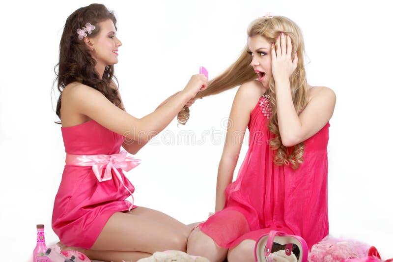 Ragazze sexy nel colore rosa fotografia stock