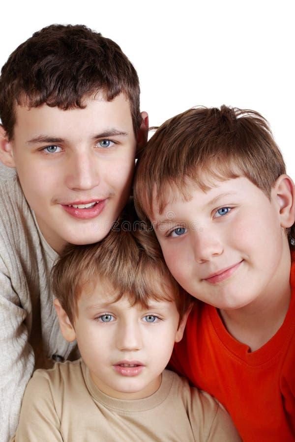 Ragazzi sorridenti del primo piano tre immagini stock libere da diritti