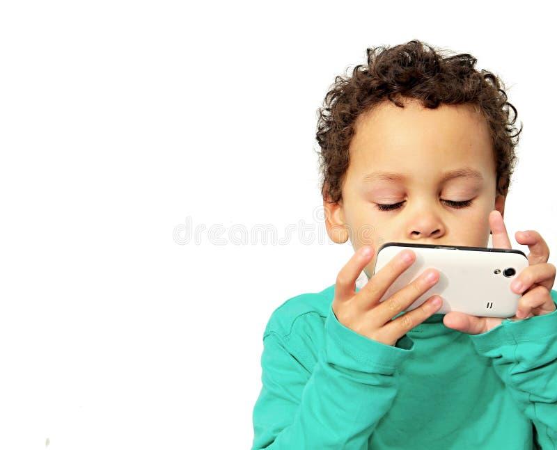 Ragazzino che fa una telefonata fotografie stock libere da diritti