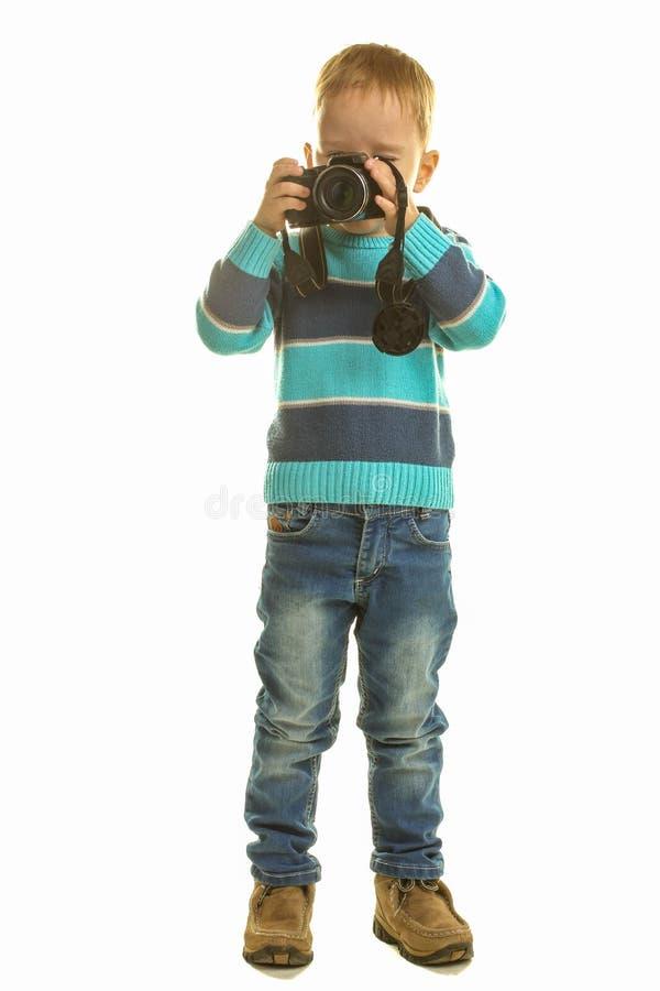 Ragazzino con la macchina fotografica fotografia stock