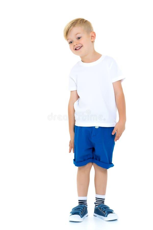 Ragazzino emozionale in una maglietta bianca pura immagine stock