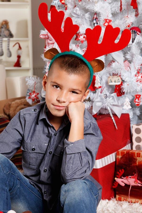 Ragazzino sveglio al Natale fotografia stock libera da diritti