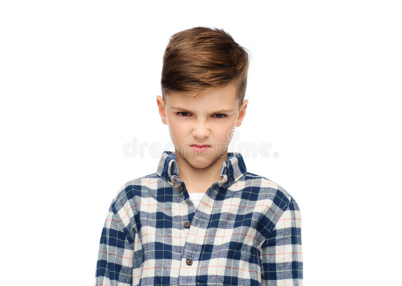 Ragazzo arrabbiato in camicia a quadretti immagine stock libera da diritti