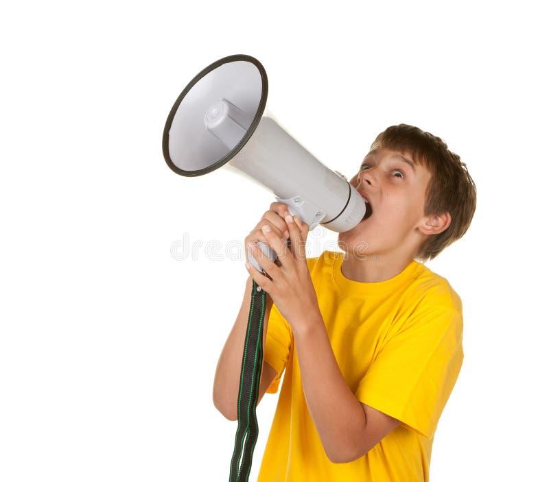 Ragazzo che urla nel megafono fotografia stock libera da diritti