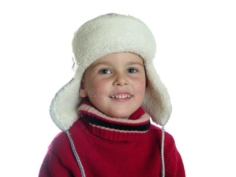 Ragazzo con il cappello con i earflaps fotografia stock
