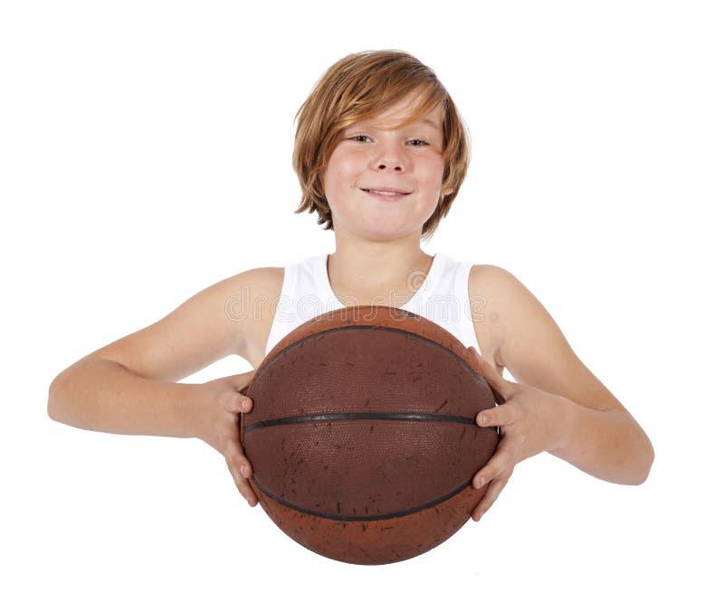 Ragazzo con pallacanestro immagini stock