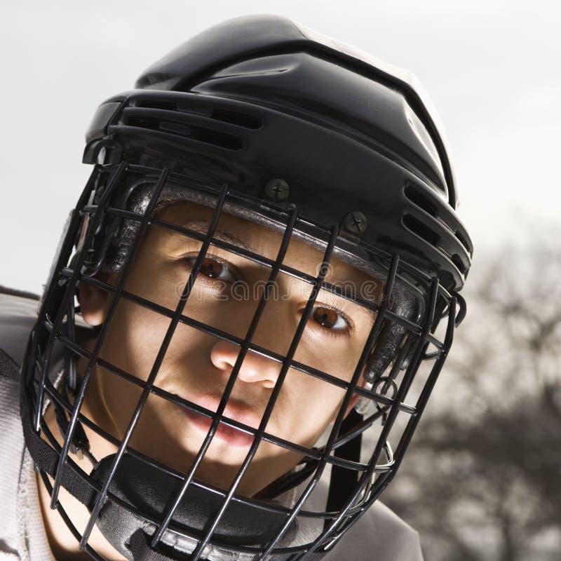 Ragazzo del giocatore di hokey del ghiaccio. immagini stock