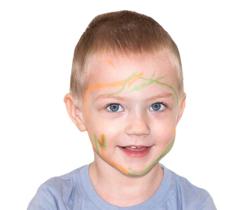 Ragazzo del piccolo bambino dipinto sulla pittura del fronte immagini stock libere da diritti