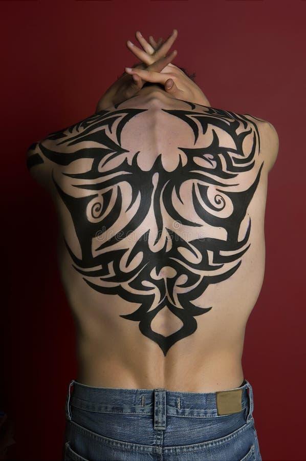 Ragazzo del tatuaggio fotografia stock