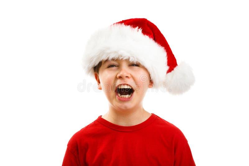 Ragazzo del tempo di Natale con Santa Claus Hat immagine stock