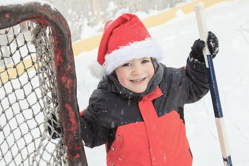 Ragazzo dell'hockey di Natale fotografia stock
