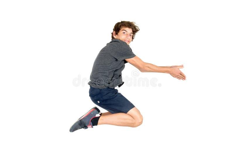 Ragazzo di salto isolato nel bianco fotografie stock