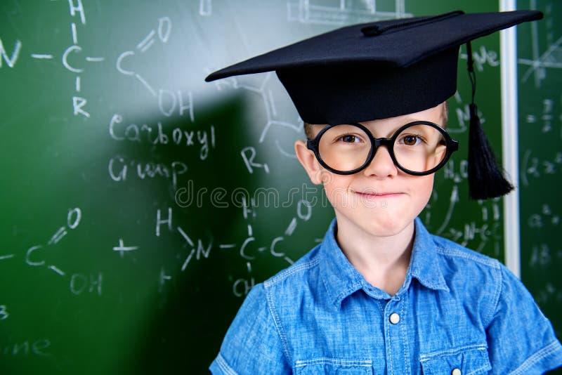 Ragazzo e istruzione di scuola fotografia stock