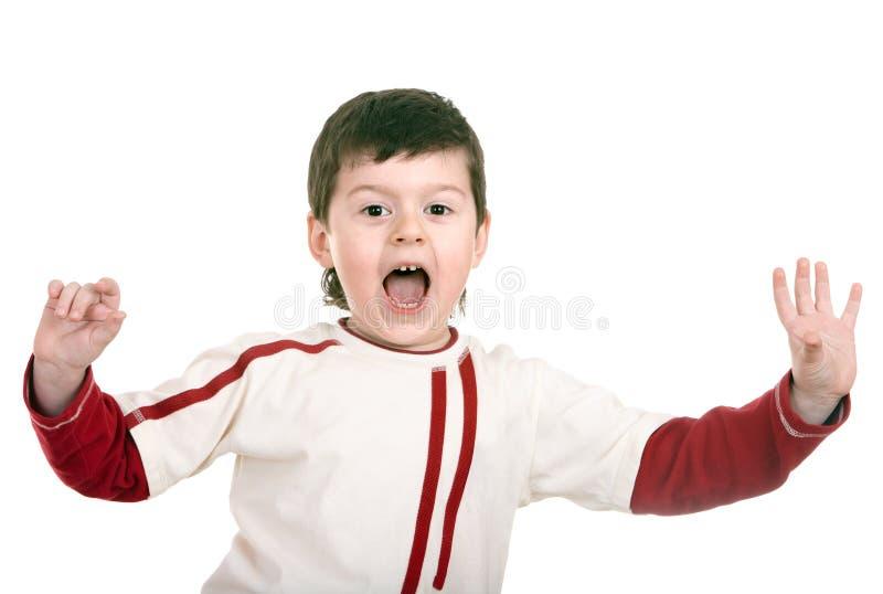 Ragazzo gridante in maglione di sport. fotografia stock libera da diritti