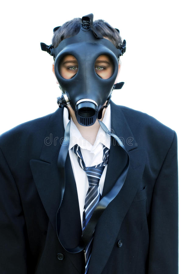 Ragazzo infelice in vestito e maschera antigas 1 immagini stock