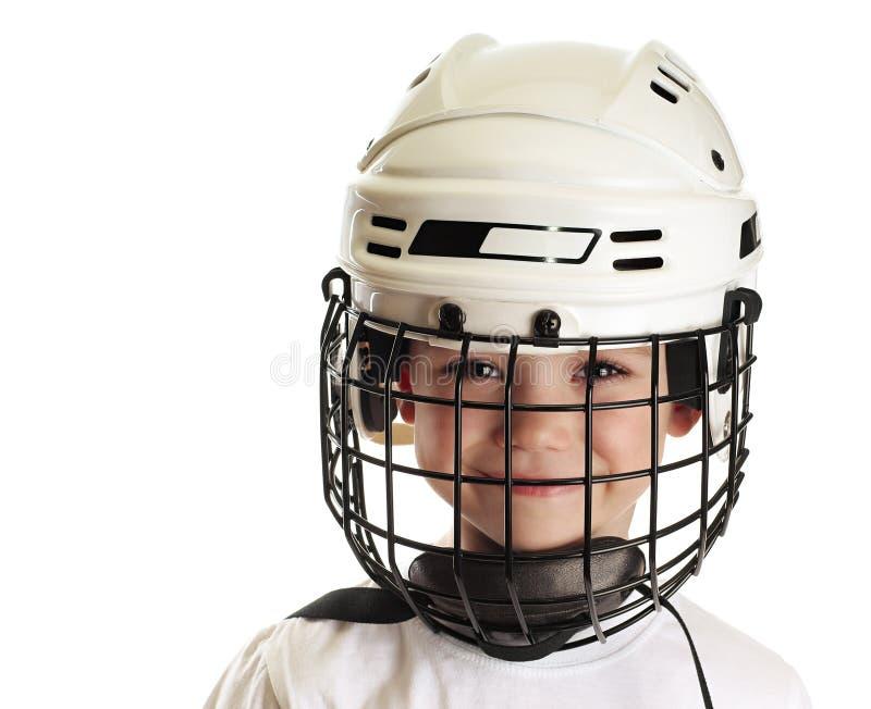 Ragazzo nel casco del hokey immagine stock