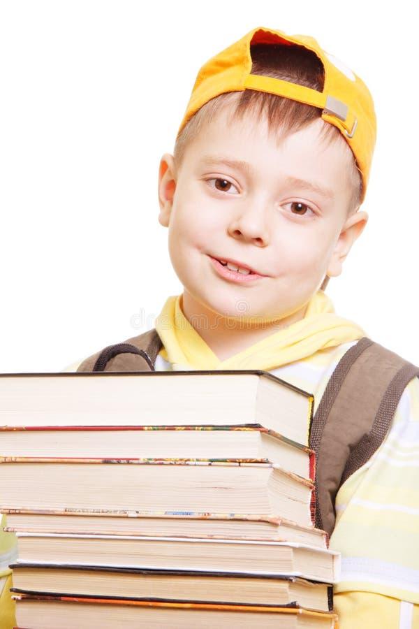 Ragazzo nel colore giallo con i libri fotografia stock