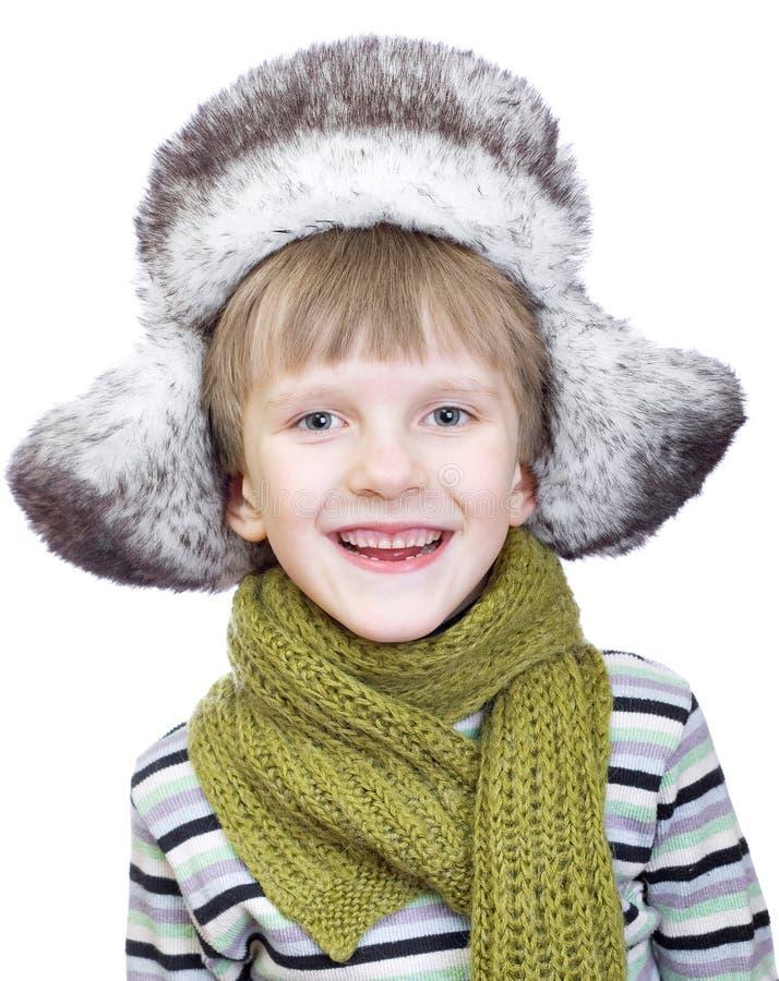Ragazzo sveglio di risata in protezione di inverno fotografie stock