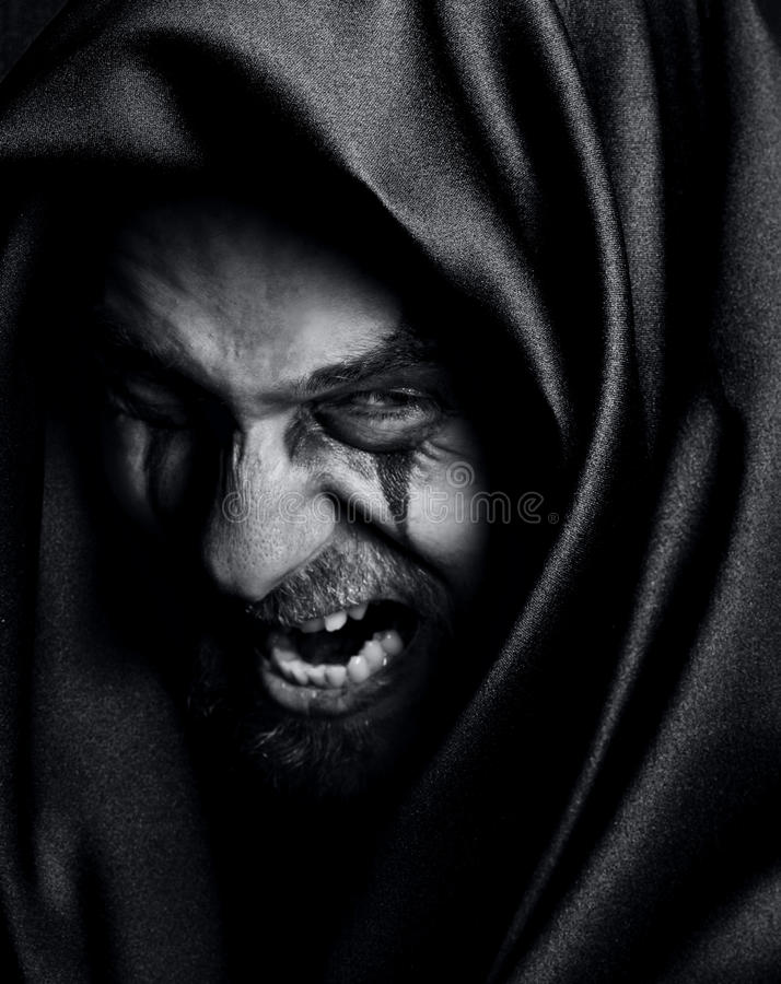 Rage of angry evil spooky malefic man stock images