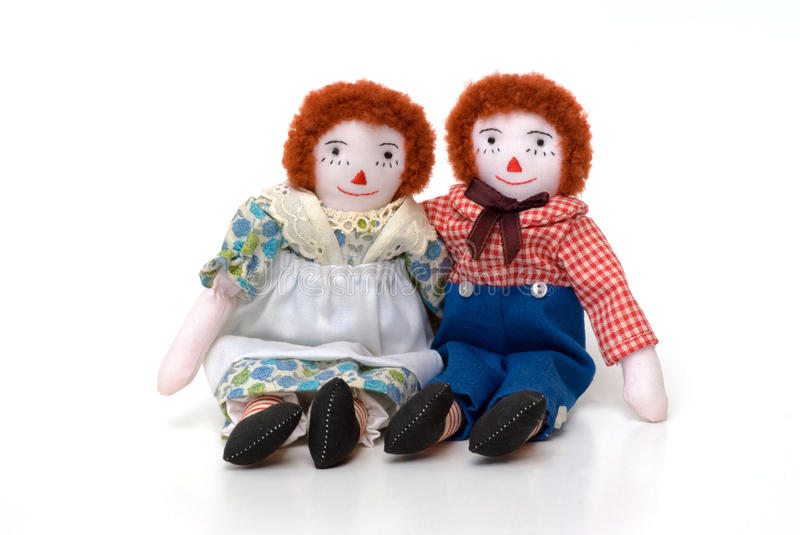 Raggedy Ann and Andy cloth dolls sitting together. Raggedy Ann and Andy are USA handmade stuffed cotton rag dolls royalty free stock images
