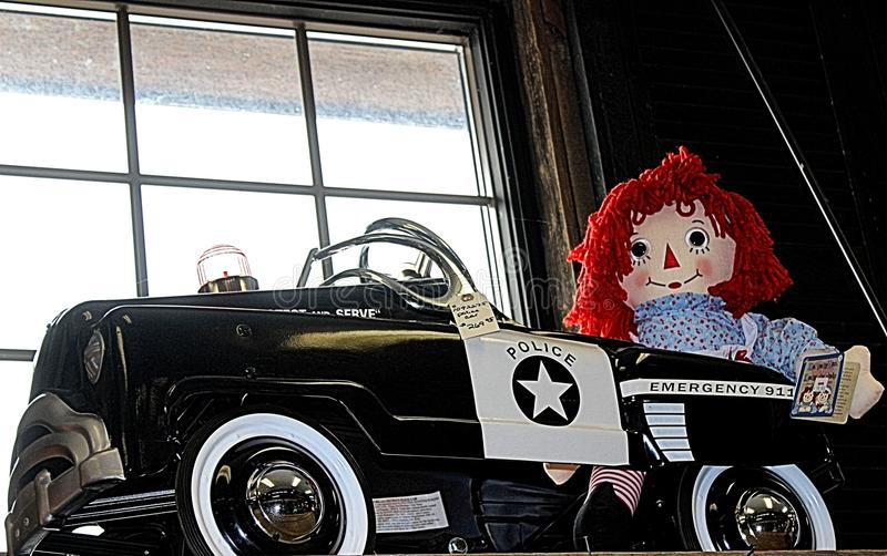 Raggedy Ann In A Police Car Toy stock photos