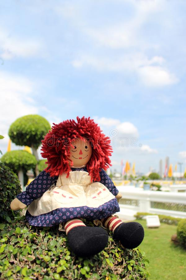 Raggedy Anne doll sitting outside, Old Time Rag Doll, Ghost mystic doll. Scary horror doll. Raggedy Anne doll sitting outside, Old Time Rag Doll, Ghost mystic royalty free stock photography