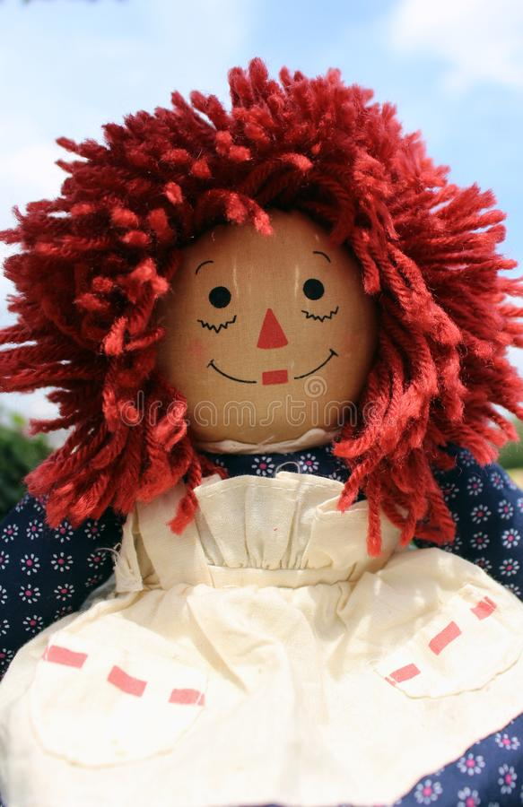 Raggedy Anne doll sitting outside, Old Time Rag Doll, Ghost mystic doll. Scary horror doll. Raggedy Anne doll sitting outside, Old Time Rag Doll, Ghost mystic royalty free stock image