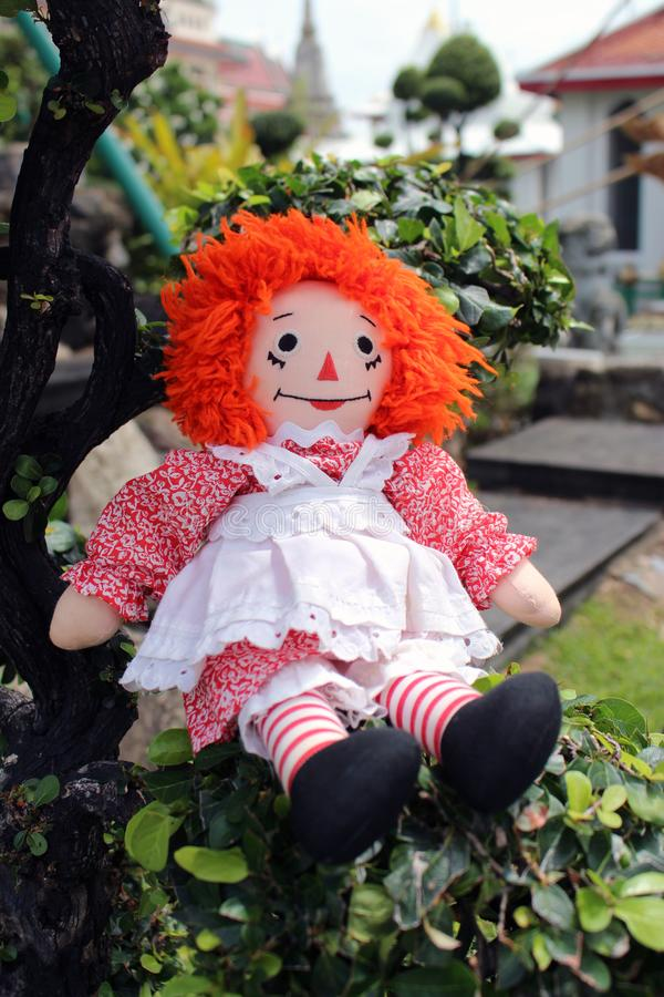 Raggedy Anne doll sitting outside, Old Time Rag Doll, Ghost mystic doll. Scary horror doll. Raggedy Anne doll sitting outside, Old Time Rag Doll, Ghost mystic royalty free stock photos