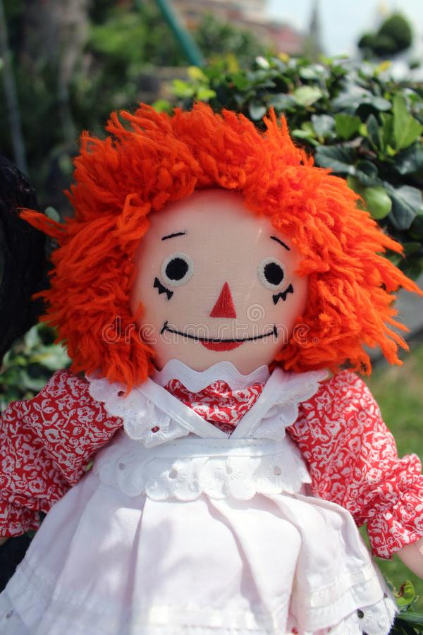 Raggedy Anne doll sitting outside, Old Time Rag Doll, Ghost mystic doll. Scary horror doll. Raggedy Anne doll sitting outside, Old Time Rag Doll, Ghost mystic stock images