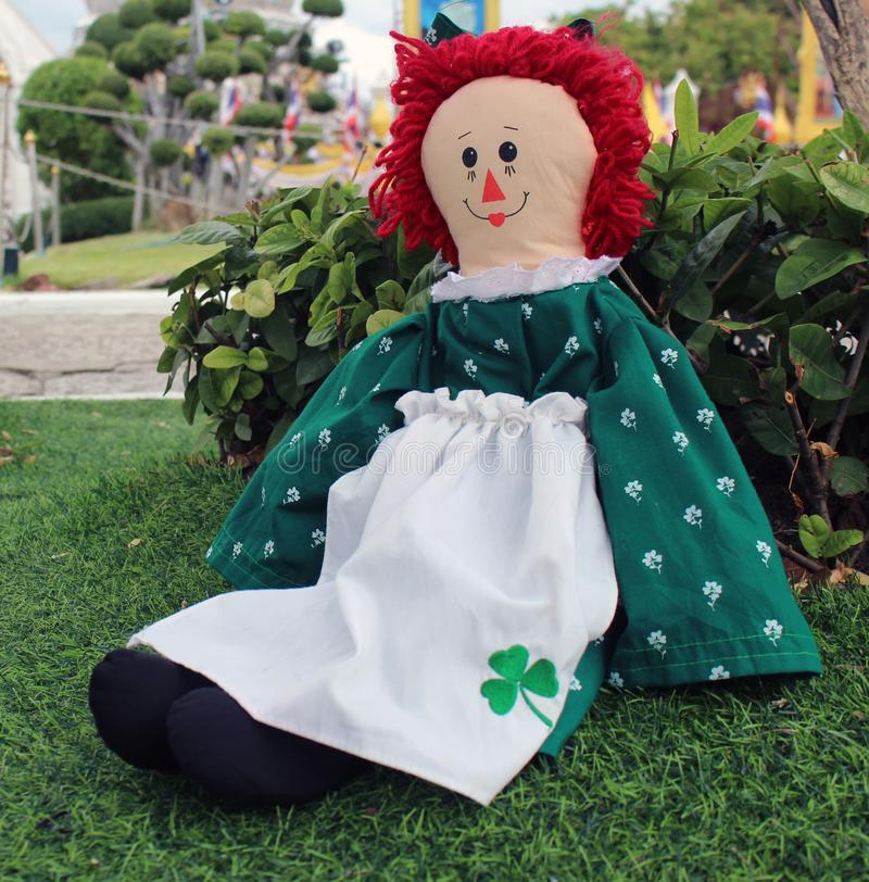 Raggedy Anne doll sitting outside, Old Time Rag Doll, Ghost mystic doll. Scary horror doll. Raggedy Anne doll sitting outside, Old Time Rag Doll, Ghost mystic stock photos