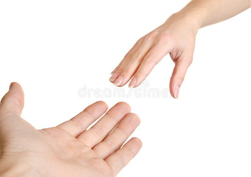 Raggiungimento delle mani. immagine stock
